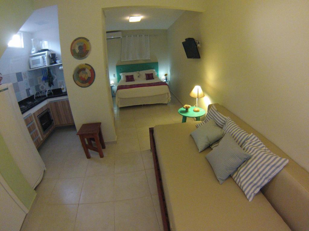 quarto sala cozinha flat casinhas do morro de sao paulo